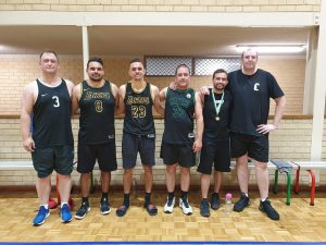 Mark with his basketball team